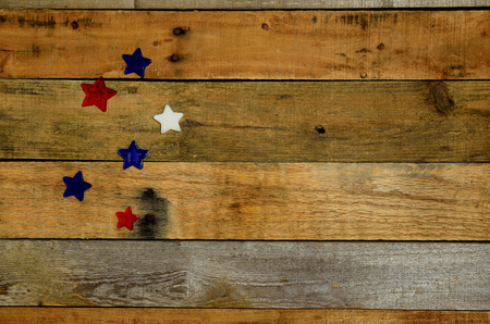 Red, white and blue stars on pallet wood background. USA Holiday, Memorial Day, Veteran's Day, 4th of July, Labor Day, President's Day. Rustic background, backdrop.