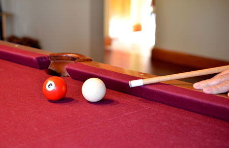 pool stick: Pool billiard balls, cue stick aimed and ready.