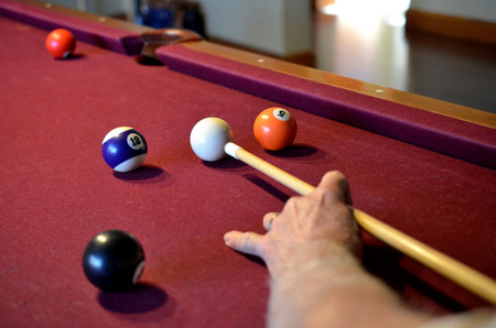 cue sticks: Pool billiard cue stick ready to hit balls