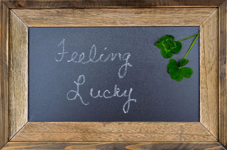 four leaf: Feeling lucky concept sign, 5 five leaf clover and 4 four leaf clover Stock Photo