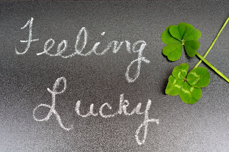 four leaf: Feeling lucky concept sign with 5 five leaf and 4 four leaf clover