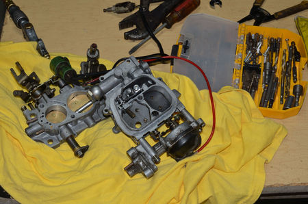 carburetor: Carburetor taken apart to clean and rebuild.  Toolkit filled with necessary mechanical tools.
