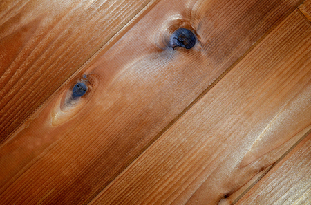 Cedar siding or flooring. Beautiful textured wood as background or abstract backdrop.