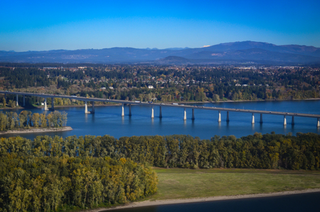 Interstate Highway bridge connecting Oregon and Washington, over the Columbia River. Scenic views of river and land.