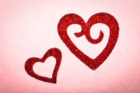Sparkle, glitter, twinkling red heart for background or backdrop.  Romantic symbol of Love.  Valentines Day, wedding, anniversary.