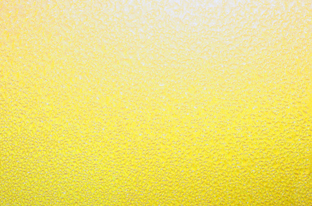 Yellow textured background. Bright, cheerful pastel yellow backdrop. Excellent springtime, summer or Easter theme. Standard-Bild - 93557113