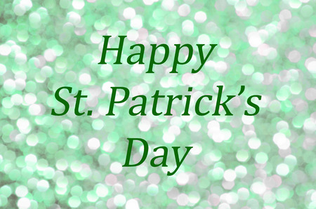 Happy St. Patrick's Day greeting with glittering green background. Celebrate this springtime festive Irish Holiday with sparkle. Standard-Bild - 93518643