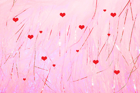 Red hearts on sparkling pink background.  Shine and twinkle for Valentine's Day holiday or romantic celebration. Standard-Bild - 95448696
