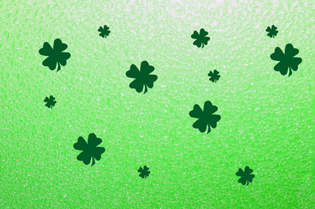 Shamrock four leaf clover on bright green background.  St. Patrick's Day festive Holiday celebration backdrop. Standard-Bild - 95626807