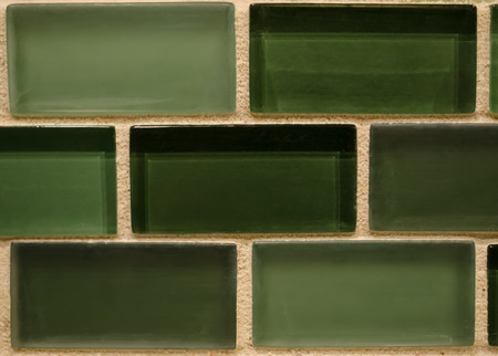 Green tile glass ceramic backdrop with cream grout. Standard-Bild - 96984254