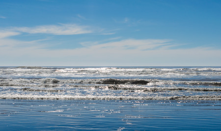 Ocean beach waves splashing on seaside shoreline. Beautiful nature scene seascape, landscape.