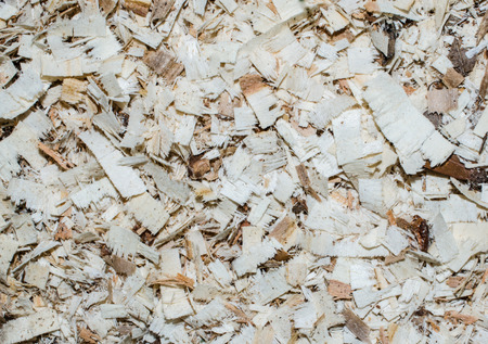 Wood saw chips, natural background or backdrop. Excellent floor for playground or walkway path.