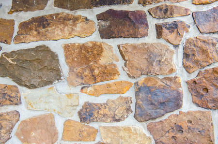 Rock stone wall. Colorful stone with texture, excellent image for background.