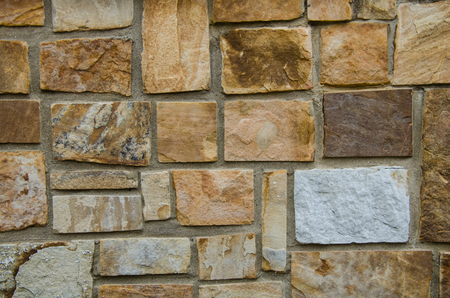 Stone wall, texture and color in this beautiful rock wall. Excellent image for background or backdrop.