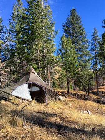 Tent camp set up in Sawtooth Mountain Range, Idaho, USA. Adventure and fun, camping, hiking and sport hunting in the wilderness. Stock Photo
