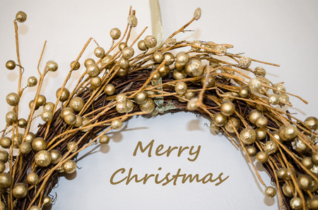 Merry Christmas greeting with beautiful festive golden decorative design.  Celebrate Christmas with sparkling message and decorations. Standard-Bild - 114070578