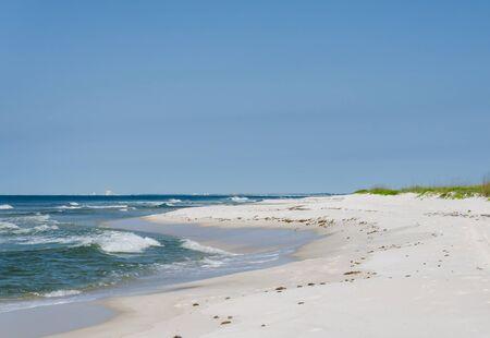 Tropical ocean beach landscape scene. Beautiful scenic tourist travel destination location. Relaxing Gulf Coast seaside beaches.