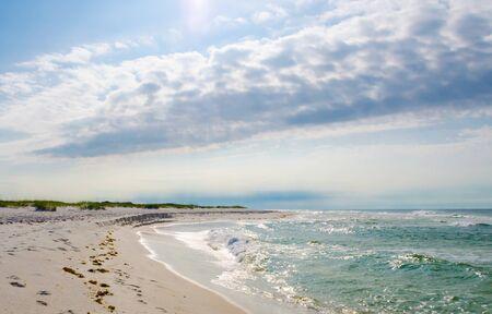 Tropical Gulf Coast ocean beach landscape scene. Beautiful scenic tourist travel destination location. Relaxing Gulf Coast seaside beaches.