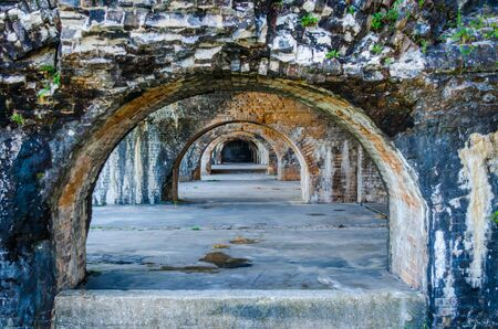 Fort Pickens structure located near Pensacola, Florida, USA. Beautiful weathered brick arches at scenic historic tourist destination location. Recreational sightseeing activity when visiting Gulf Coast beaches.