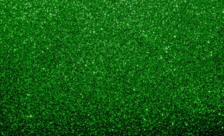Emerald green, glitter, sparkle and shine abstract background. Excellent backdrop for festive Holiday's, including Christmas, New Year and St. Patrick Day.  Deep Rich vibrant dark green color.