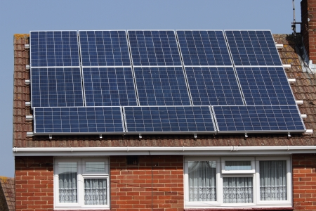 Solar photovoltaic panels on house roof photo