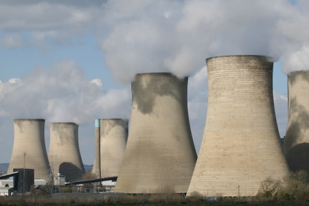 emanating: Cooling chimney towers emanating steam from coal fuelled power station Stock Photo