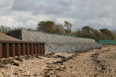 gabion: Coastal erosion defences in the form of stone-filled wired gabion baskets