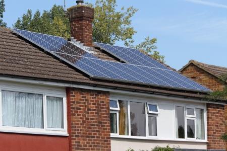 Solar photovoltaic panel array on house roof photo