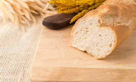 artisan bakery: Sharp sliced of french bread baguettes on bread board