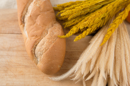 artisan bakery: French bread baguettes on bread board on burlap texture Stock Photo