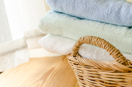 towel: Selective focus of towels in wicker basket at home