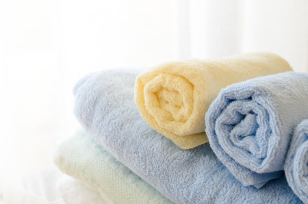 laundrette: Selective focus of rolled bath towels at home