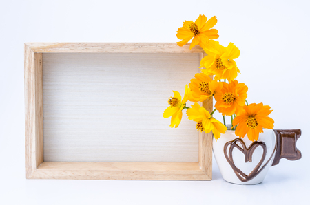 photo paper: Photo frame with books and flowers on the wooden table