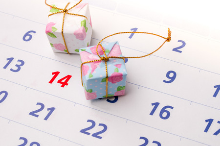 Close up of a calendar with focus on day 14