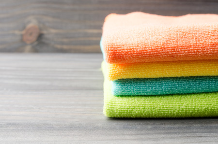 lavender coloured: Colorful bath towels on wooden background closeup