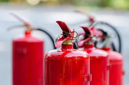 Red tank of fire extinguisher
