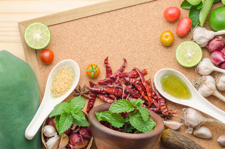 Ingredients for making papaya salad on a wooden table. Set of Thai spices and herbs Stock Photo