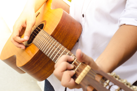 Young man playing acoustic guitar. Stock Photo