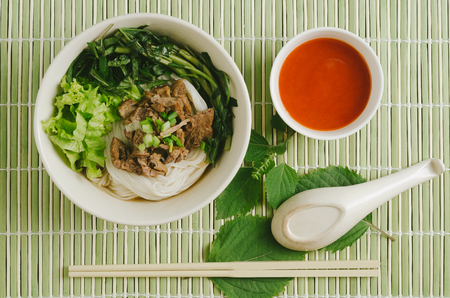 Rice noodles soup with vegetables and meat. Thai food concept.