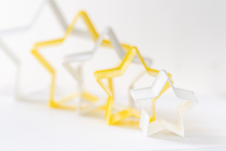 Cloase up star shaped pastry cutter on a white background