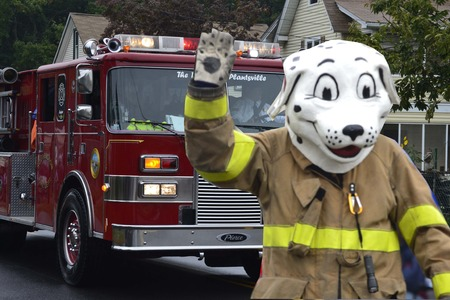 firetruck: Costume of a man of a dalmatian in front of firetruck