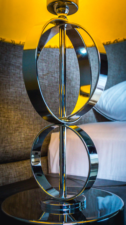 detail of bedside table lamp metal stand
