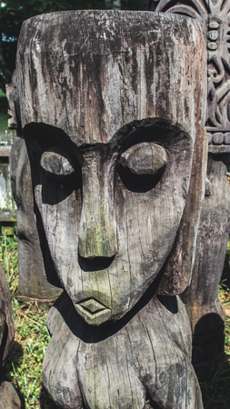 Face of traditional Dayaknese wood sculpture totem in Pulau Kumala, Indonesia Stok Fotoğraf