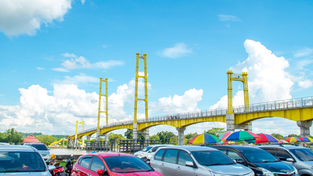 cars parking with bridge as the background Editorial