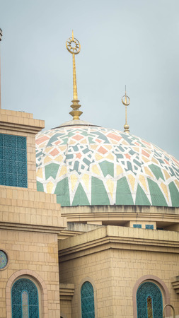 facade of the mosque with gcolorful dome. Samarinda Islamic Center, Indonesia Stock Photo