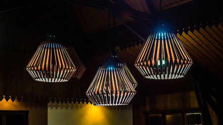 decorative lamp hanging on wooden ceiling. interior concept