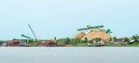 wood chip stockpile  factory on Mahakam riverbank. industrial background