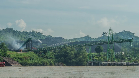 Coal stockpile on upper Mahakam riverbank, Indonesia