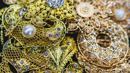 closeup of glamorous jewelry. Pile of gold, pearl, silver, gemstone jewelry Stock Photo