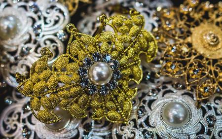 closeup of glamorous jewelry. Pile of gold, pearl, silver, gemstone jewelry Stock Photo